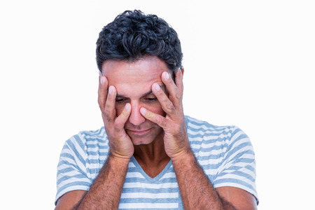 bleakness: Sad man with hands on head on white background Stock Photo