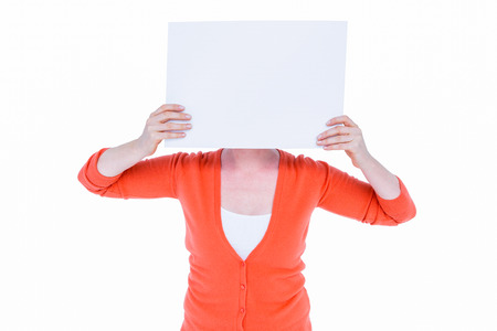 papier vierge: Woman hiding his head with blank paper on white background Banque d'images