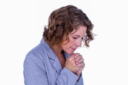 Pretty brunette Frau beten auf weißem Hintergrund Standard-Bild - 42595048