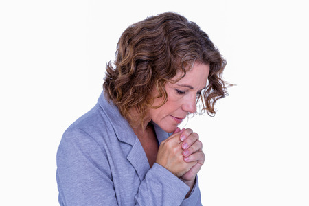 Pretty brunette woman praying on white background Stock Photo