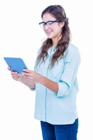 geeky: Pretty geeky hipster holding tablet on white background Stock Photo