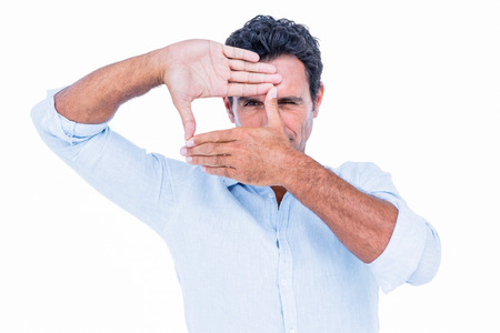 gesturing: A serious handsome man gesturing on white background