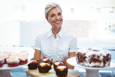 self assured: Selfassured female waitress in the bakery
