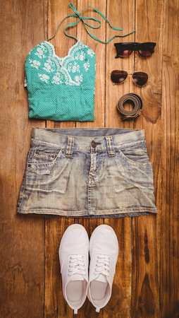 hot pants: Differents objects using every days for the summer on wooden table