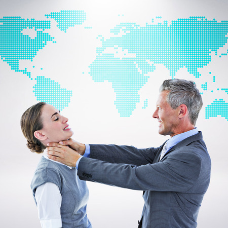 Business team fighting against green world map on white background