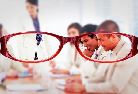 charismatic: Glasses against charismatic businesswoman doing a presentation Stock Photo