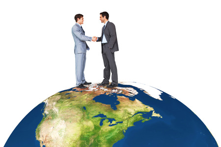 introduction: Businessmen shaking hands against earth