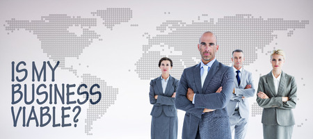 viable: Business colleagues smiling at camera against orange world map on white background Stock Photo