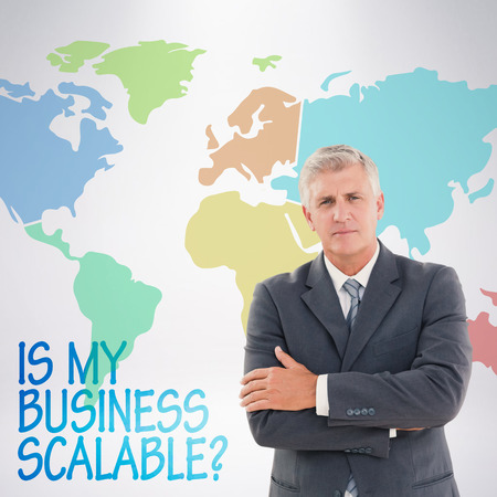 serious businessman: Serious businessman against grey background Stock Photo