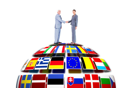 international flags: Businessman and woman shaking hands against flag sphere