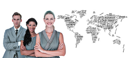 buzzwords: Happy business team smiling at camera  against world map of buzzwords Stock Photo
