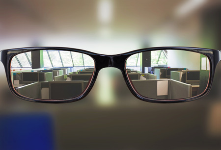 the silence of the world: Glasses against empty office with separate units