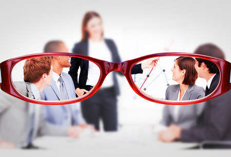 assertive: Glasses against assertive businesswoman giving a presentation Stock Photo