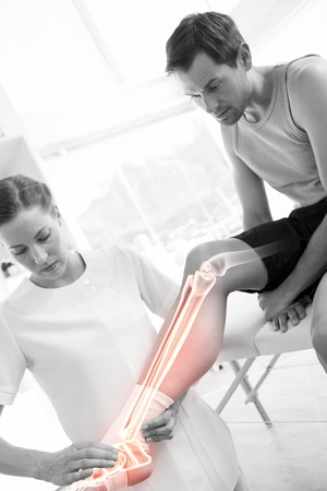 physiotherapy: Digital composite of Highlighted knee of injured man at physiotherapist Stock Photo