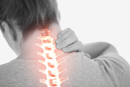digital composite: Digital composite of Highlighted spine of woman with neck pain