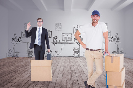 Happy delivery man leaning on trolley of boxes against doodle office in room Stock Photo
