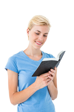 jehovah: Pretty blonde woman reading bible on white background Stock Photo