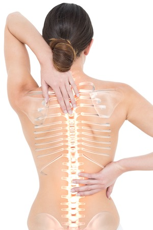 nude brunette: Digital composite of Highlighted spine of woman with back pain Stock Photo