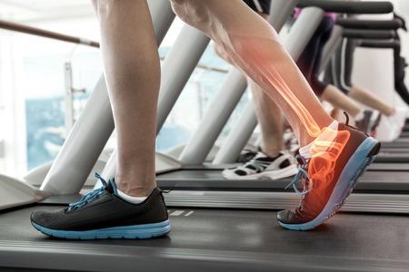 Digital composite of Highlighted bones of man on treadmill Stok Fotoğraf
