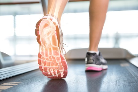 digital composite: Digital composite of Highlighted foot of woman on treadmill