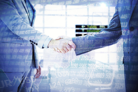 stocks and shares: Business handshake against stocks and shares