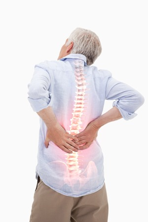 BACK bone: Digital composite of Highlighted spine of man with back pain
