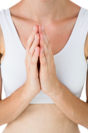brethren: Fit woman praying on white background Stock Photo