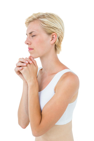 jehovah: Pretty blonde woman praying on white background
