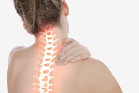 Digital composite of Highlighted spine of woman with neck pain