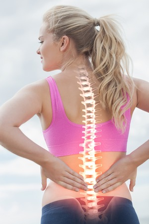 ache: Digital composite of Highlighted spine of woman with back pain Stock Photo