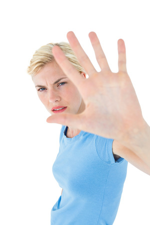 stern: Stern woman gesturing with her hand on white background