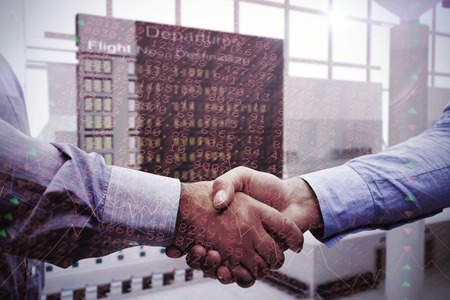 stocks and shares: Men shaking hands against stocks and shares