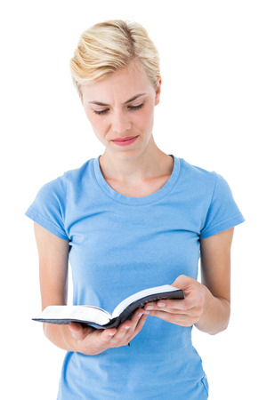 jehovah: Blonde woman reading bible on white background