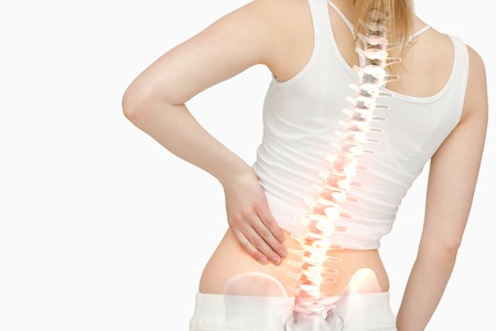 woman back: Digital composite of Highlighted spine of woman with back pain Stock Photo