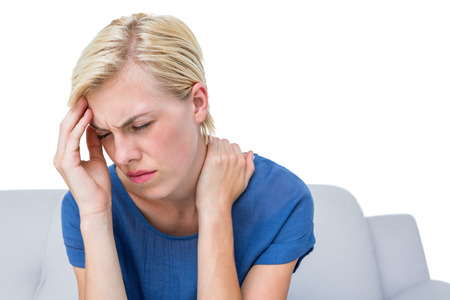 apprehensive: Attractive woman having headache on white background