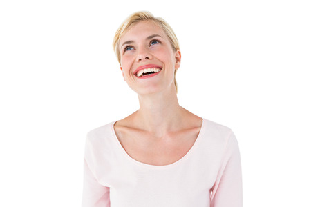 looking up: Attractive blonde woman looking up on white background