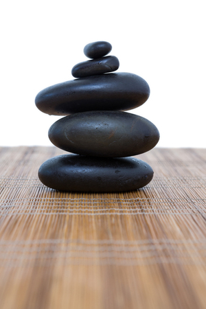 spirituality therapy: Tower of pebbles on white background Stock Photo