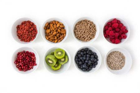 Bowls of healthy food on white background