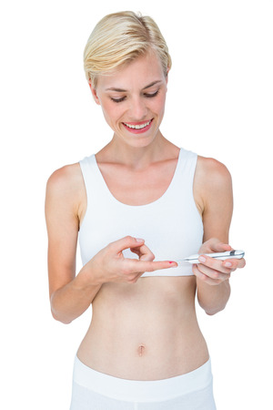 cut outs: Attractive blonde woman doing test with blood glucose monitor on white background
