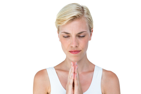 jehovah: Attractive blonde woman praying on white background
