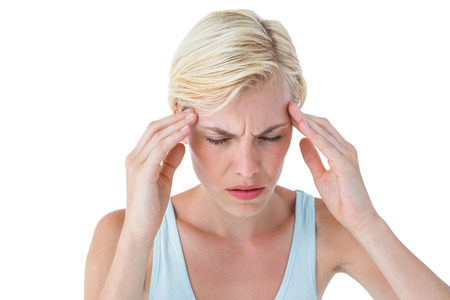 pounding head: Attractive woman having headache on white background