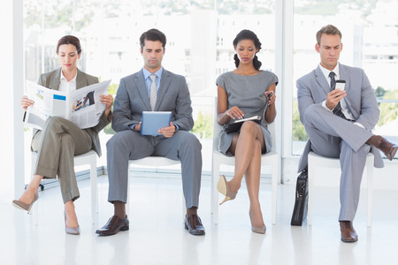 well read: Business people sitting and waiting in the office