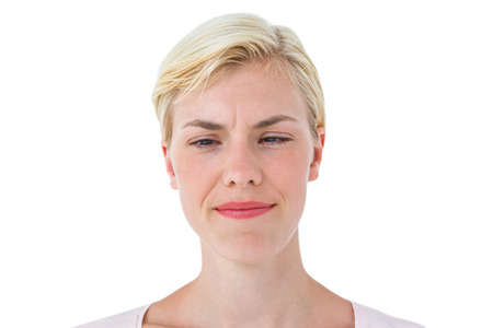 frowning: Serious woman frowning on white background Stock Photo