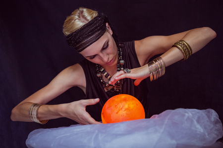 fortune teller: Fortune teller forecasting the future on black background