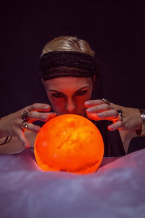 telepathy: Fortune teller forecasting the future on black background
