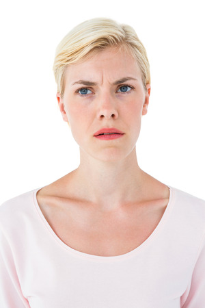 doubtful: Doubtful blonde woman on white background