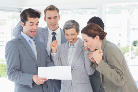 new contract: Business team celebrating a new contract in the office