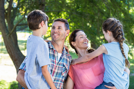 fun activity: Happy family in the park together on a sunny day Stock Photo