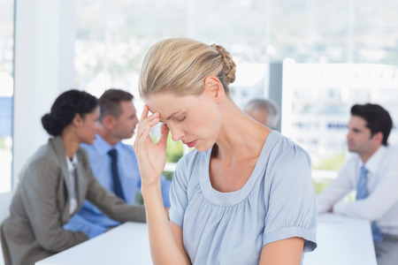 young business people: Disappointed businesswoman and her team in the office