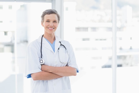doctor of medicine: Smiling female doctor in medical office